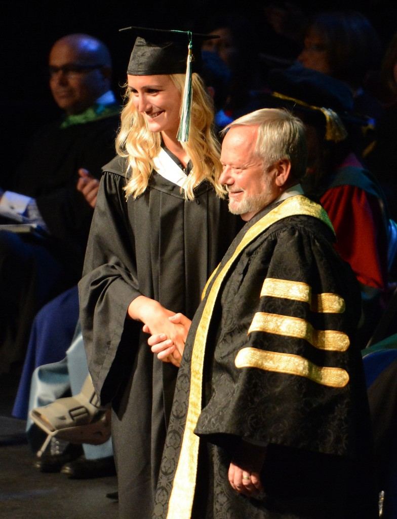 Sarah Wierks shakes hands with UFV president and vice-chancellor Dr. Mark Evered during convocation ceremonies in June. Wierks graduated with a Bachelor of Kinesiology degree.