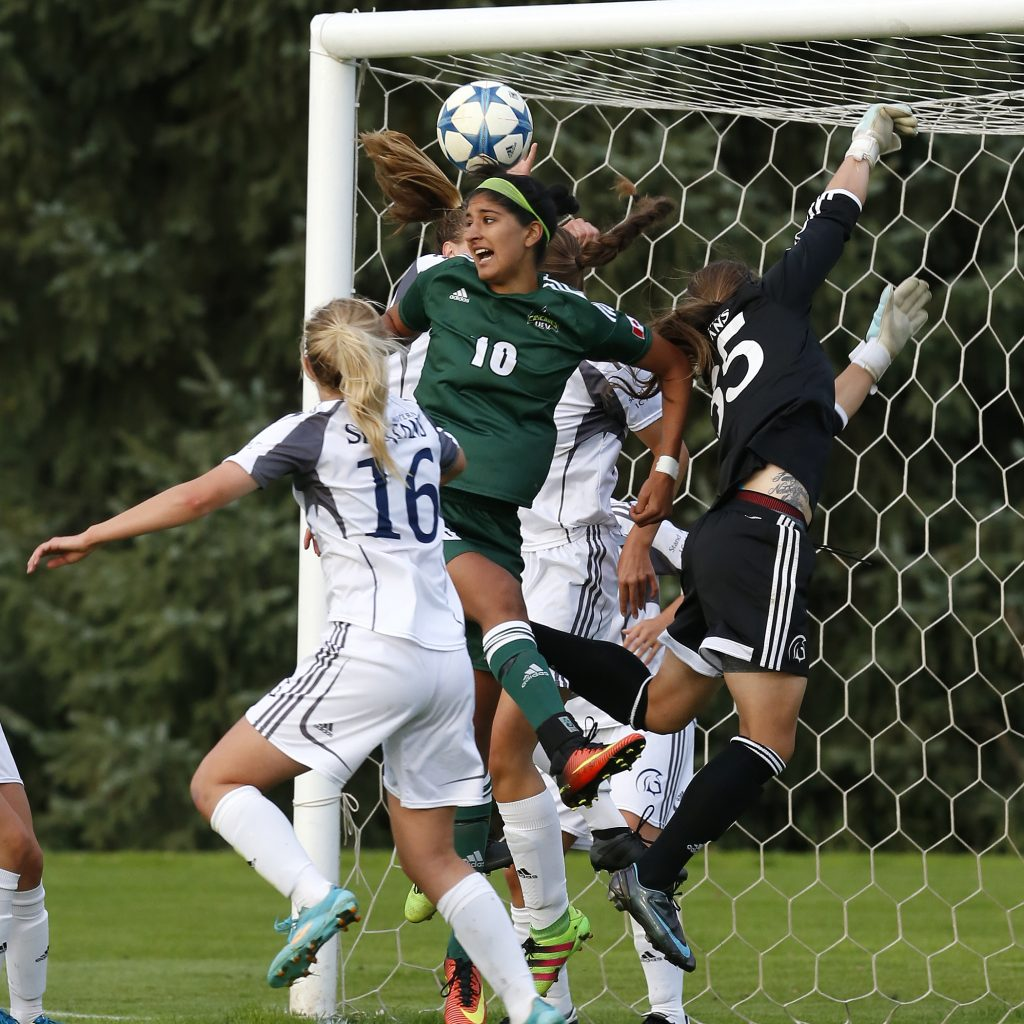 UFV's Simi Lehal leaps for a header.