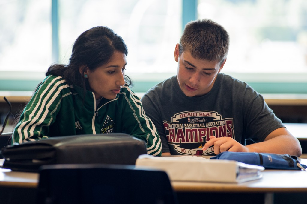 Jaslyen Singh helps a student with his French homework.