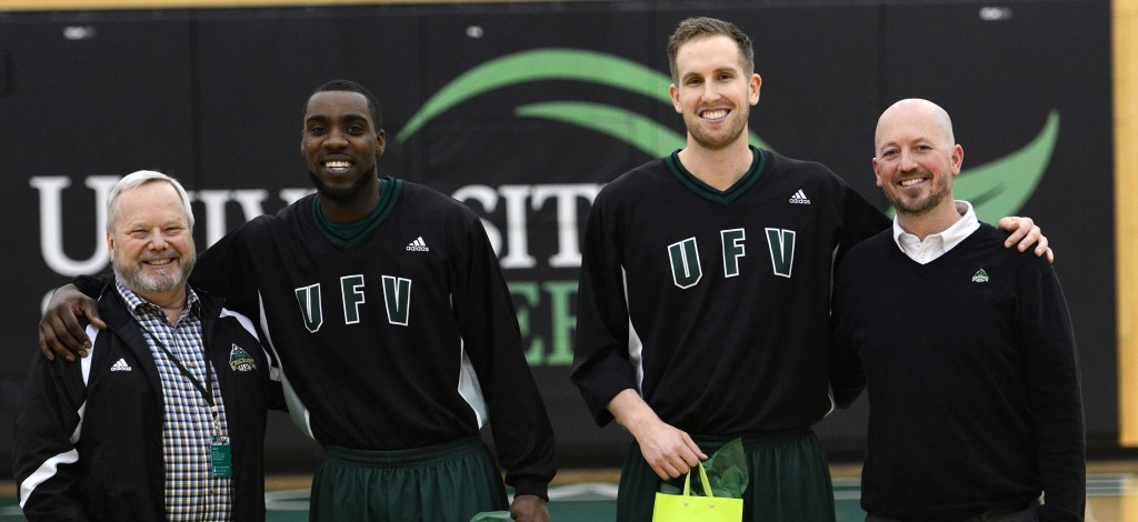 UFV president Mark Evered (left) and Cascades interim athletic director Chris Bertram (right) were on hand to honour graduating seniors Kadeem Willis and Jasper Moedt prior to their final regular season home game.
