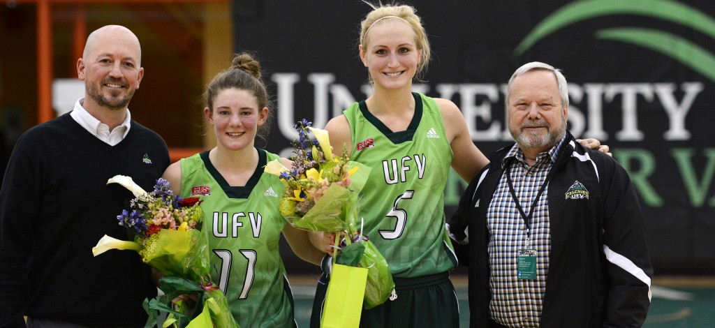 UFV interim athletic director Chris Bertram (left) and president Mark Evered (right) celebrated the careers of graduating fifth-year Cascades Celeste Dyck and Sarah Wierks on Saturday.