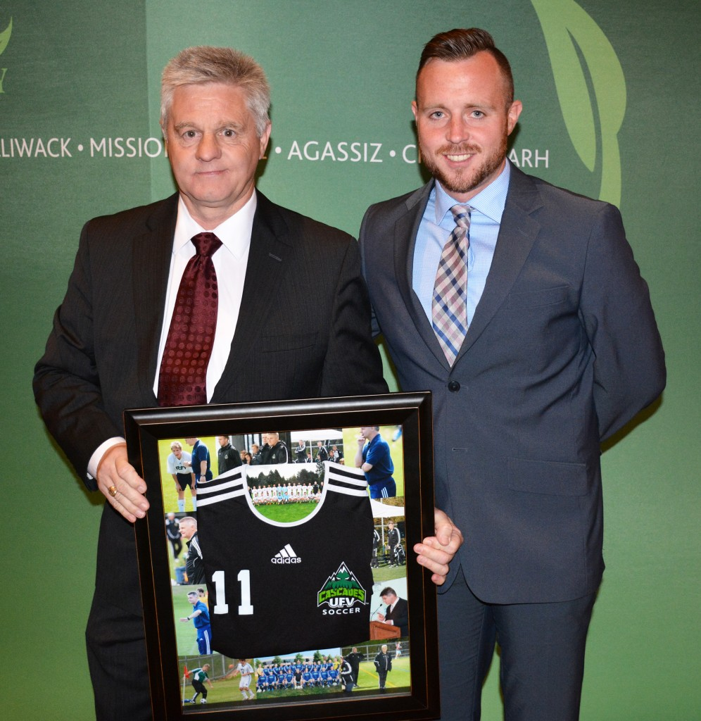 Tom Lowndes, Alan Errington's successor at the helm of the Cascades men's soccer program, presented Errington with a framed jersey during the UFV athletic awards banquet on Tuesday in honour of his retirement.