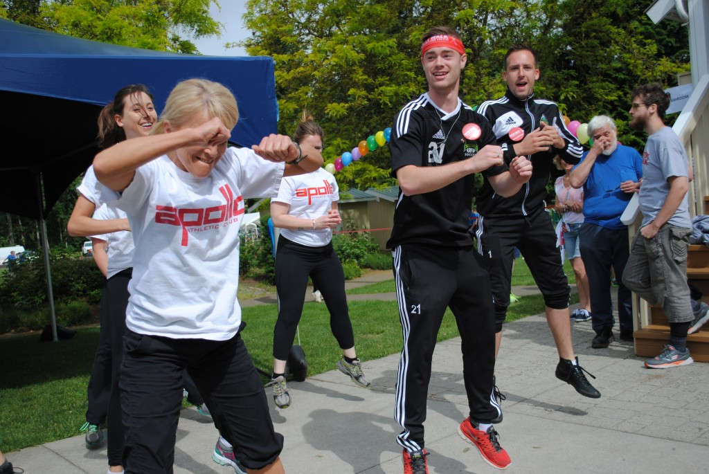 Cascades men's soccer players James Najman and Mark Village helped lead the warm-up at the 2014 Abbotsford Gutsy Walk.