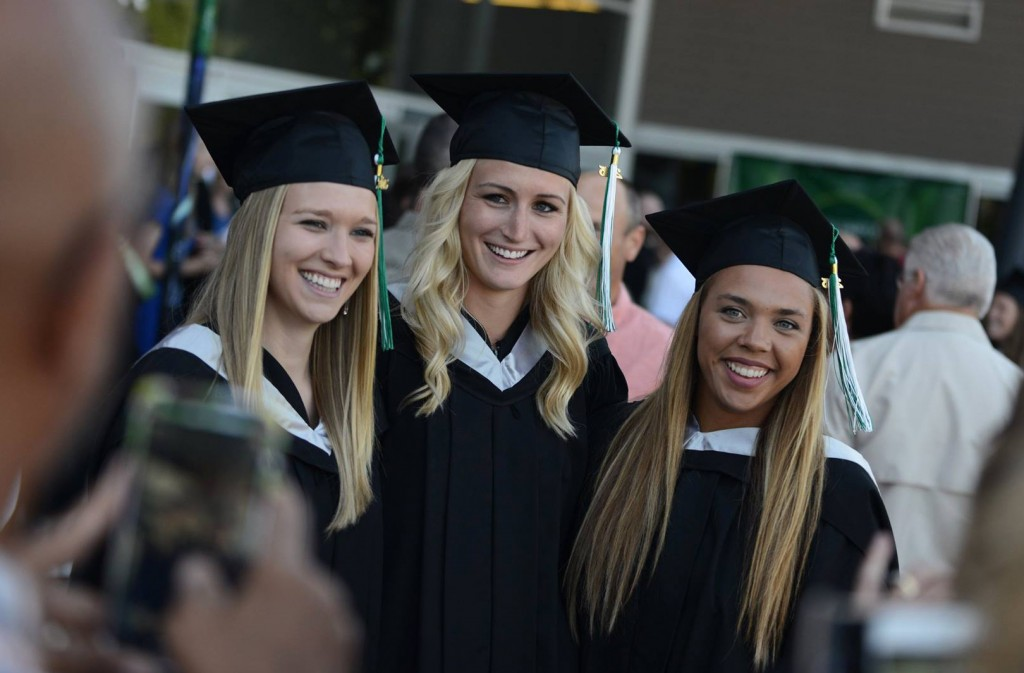 Courtney Bartel, Sarah Wierks and Aieisha Luyken, formerly of the Cascades women's basketball team, pose for photos outside Abbotsford Centre following Thursday afternoon's convocation ceremony. All three received Bachelor of Kinesiology degrees. (Darren McDonald photo)