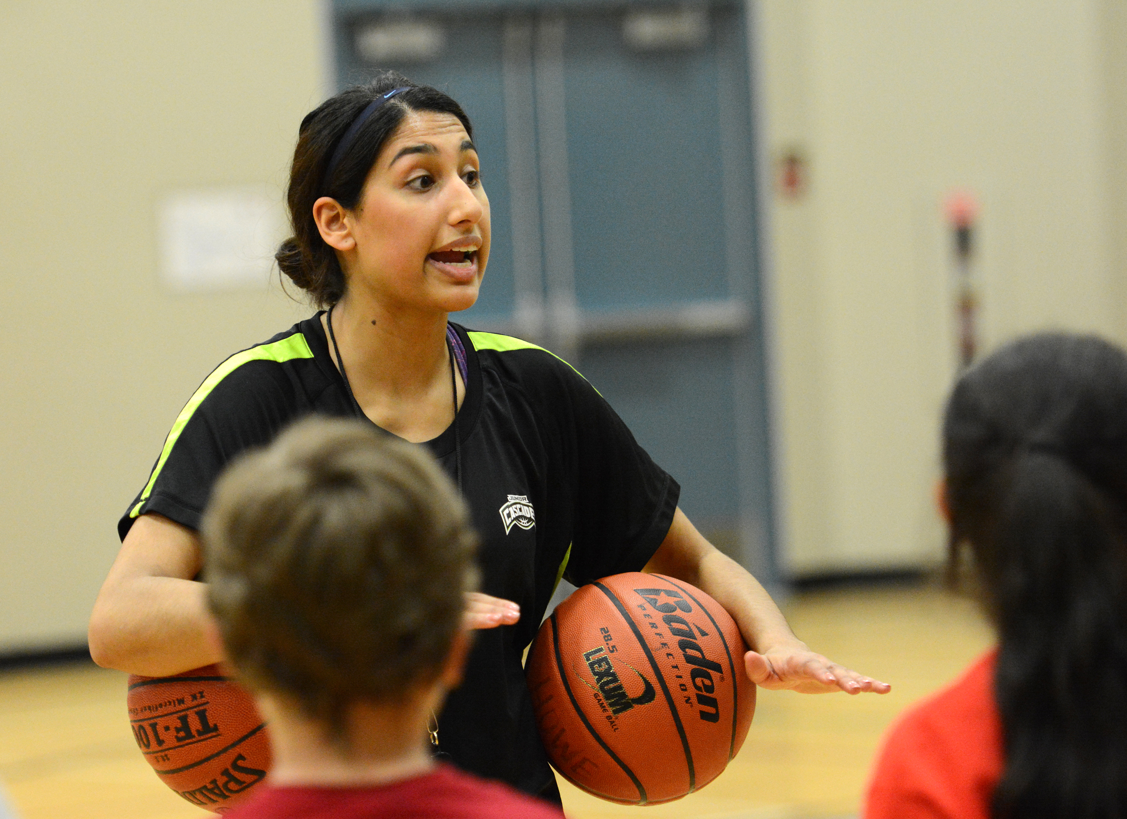 Jaslyen Singh gives instructions to Howe Middle School students during a recent Books and Basketball session. The program, now in its second year, features Cascades basketball players serving as coaches and tutors for Grade 6 and 7 students.