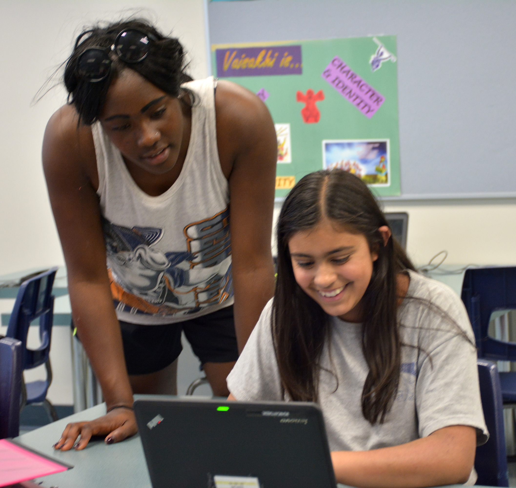 Jenika Bannerman of the UFV women's basketball team interacts with a student during a recent Books and Basketball study session.