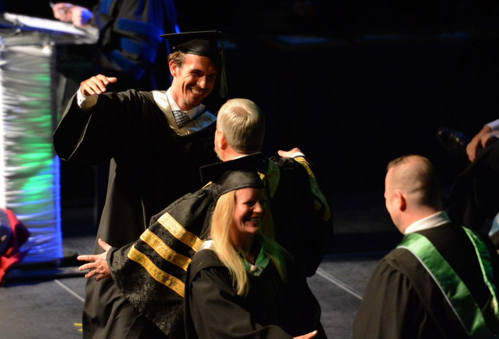 Dalibor Plavsic (MSOC) goes for a hug with UFV president Dr. Mark Evered.
