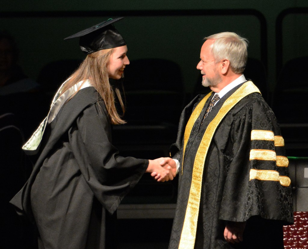 Suzanne Kubat of the Cascades rowing team received congratulations from Dr. Mark Evered on her Bachelor of Kinesiology degree.