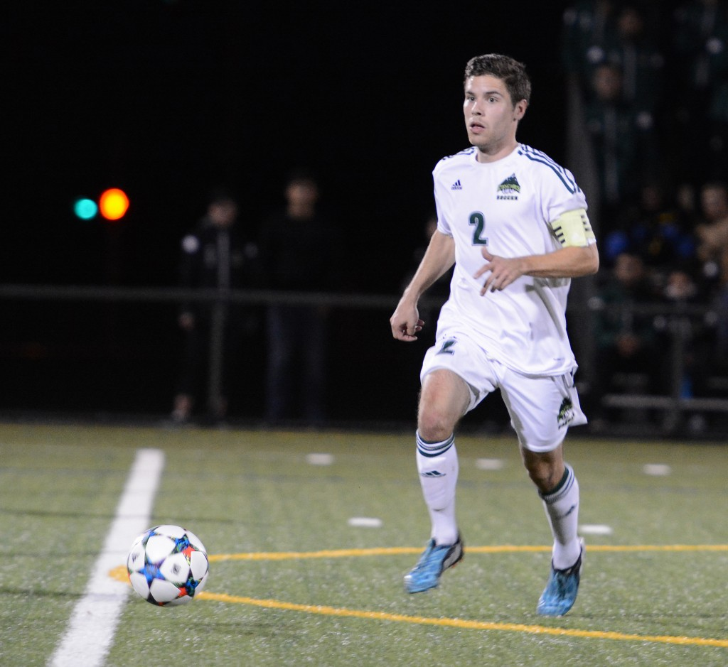 Cascades captain Colton O'Neill pushes the ball up the pitch.