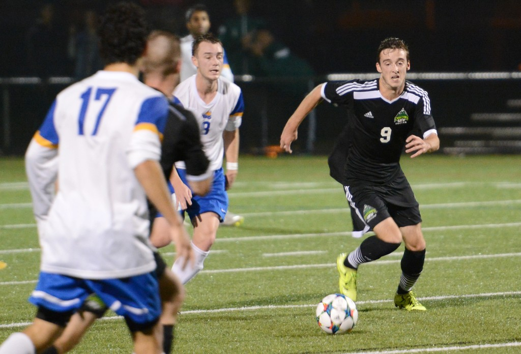 UFV striker Daniel Davidson chases down a loose ball during Saturday's clash with UVic.