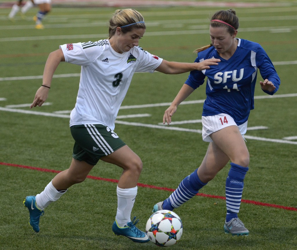 Danica Kump of the Cascades looks for room to operate against SFU's Tanis Cuthbert during Wednesday's exhibition game at Abbotsford Senior Secondary.