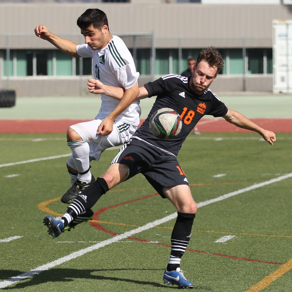 UFV's Michael Mobilio battles with TRU's Keenan Wallace during Sunday afternoon's game in Kamloops.