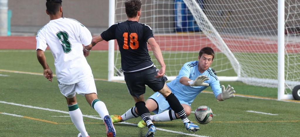 Cascades keeper Alex Skrzeta turns aside a shot from TRU's Mitchell Popadynetz.(Andrew Snucins photos)