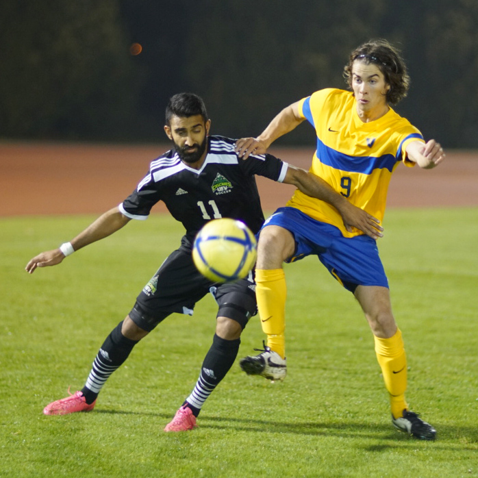 UFV's Justin Sekhon (left) battles with a UVic opponent on Friday (Victoria Vikes photo)