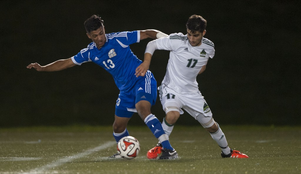 UFV midfielder Michael Mobilio battles for possession with UBC's Kerman Pannu. (Rich Lam / UBC Thunderbirds)