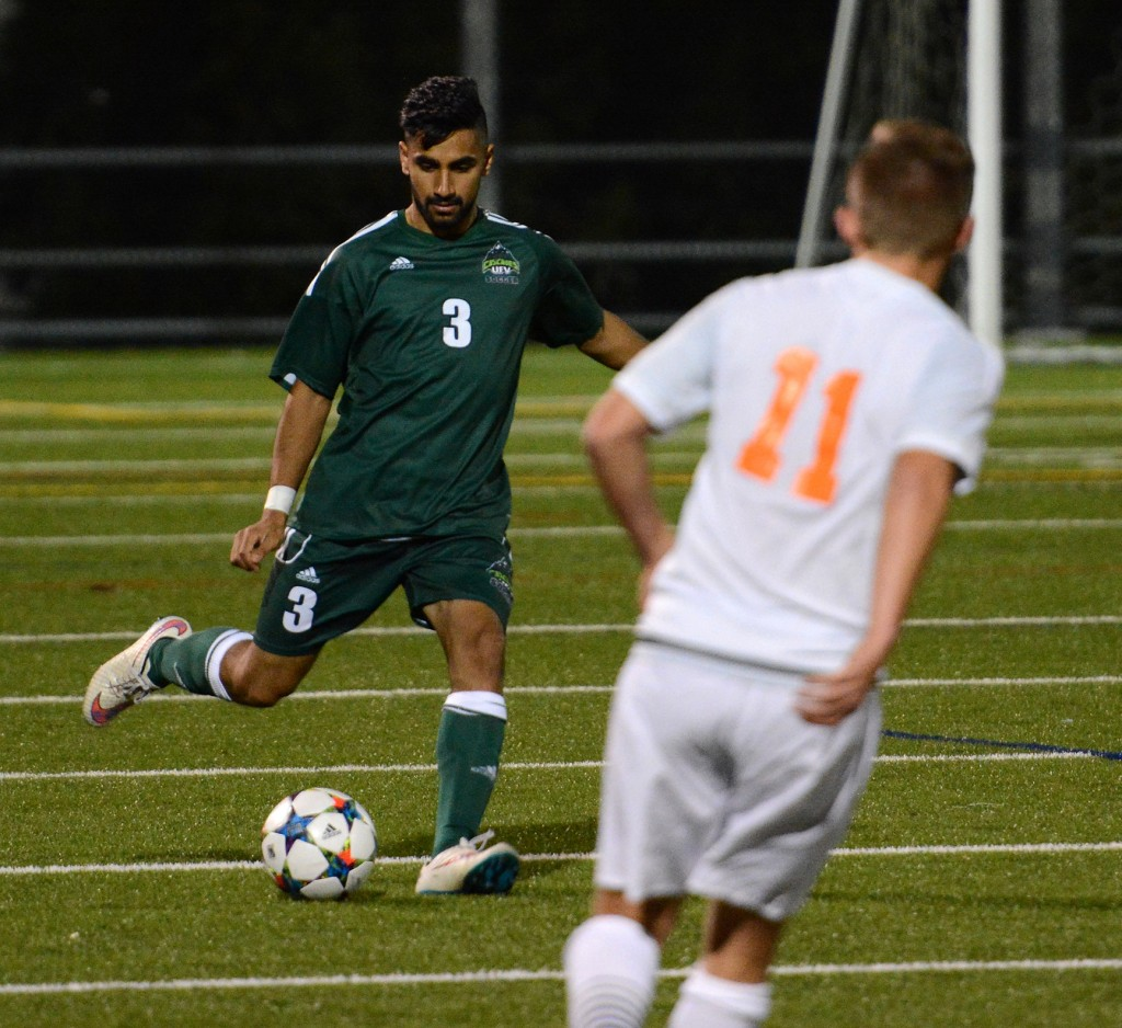 Cascades defender Sukhjit Dhaliwal plays the ball ahead during Saturday's home game vs. Thompson Rivers.