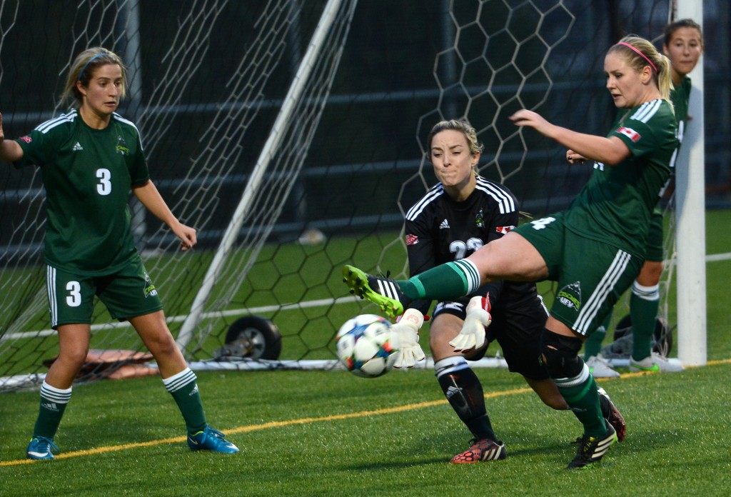 Cascades defender Dayle Jeras (right) and keeper Emily Harold combined to keep a Winnipeg Wesmen corner from finding its way into the net on Saturday.