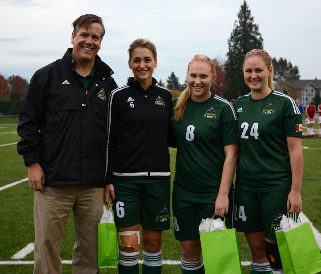 Graduating fifth-years Jade Palm, Shelby Beck and Dayle Jeras were honoured during a pregame ceremony with Cascades athletic director Steve Tuckwood.