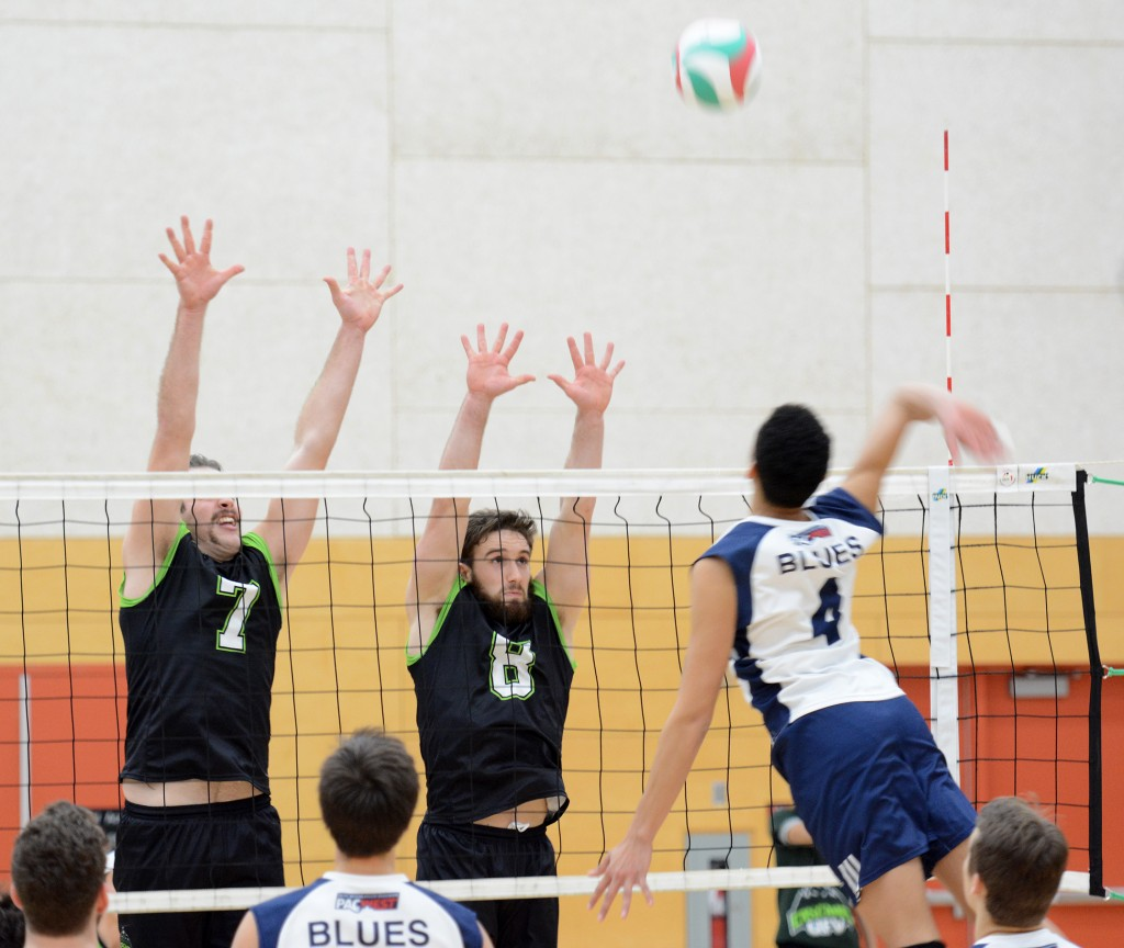UFV's Dayton Pagliericci and Adam Chaplin go up for a block.