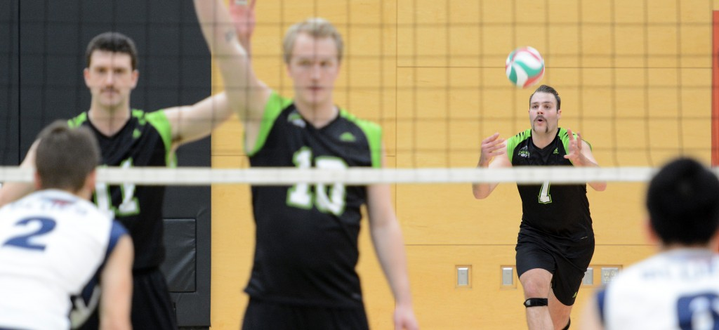 Dayton Pagliericci (No. 7, serving) played a key role in the Cascades' four-set win over Capilano on Saturday.