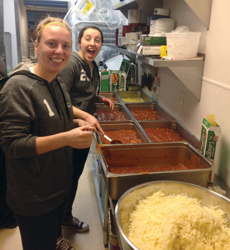 Goalkeepers Kayla Klim (left) and Risa Venuto had fun preparing the meal.
