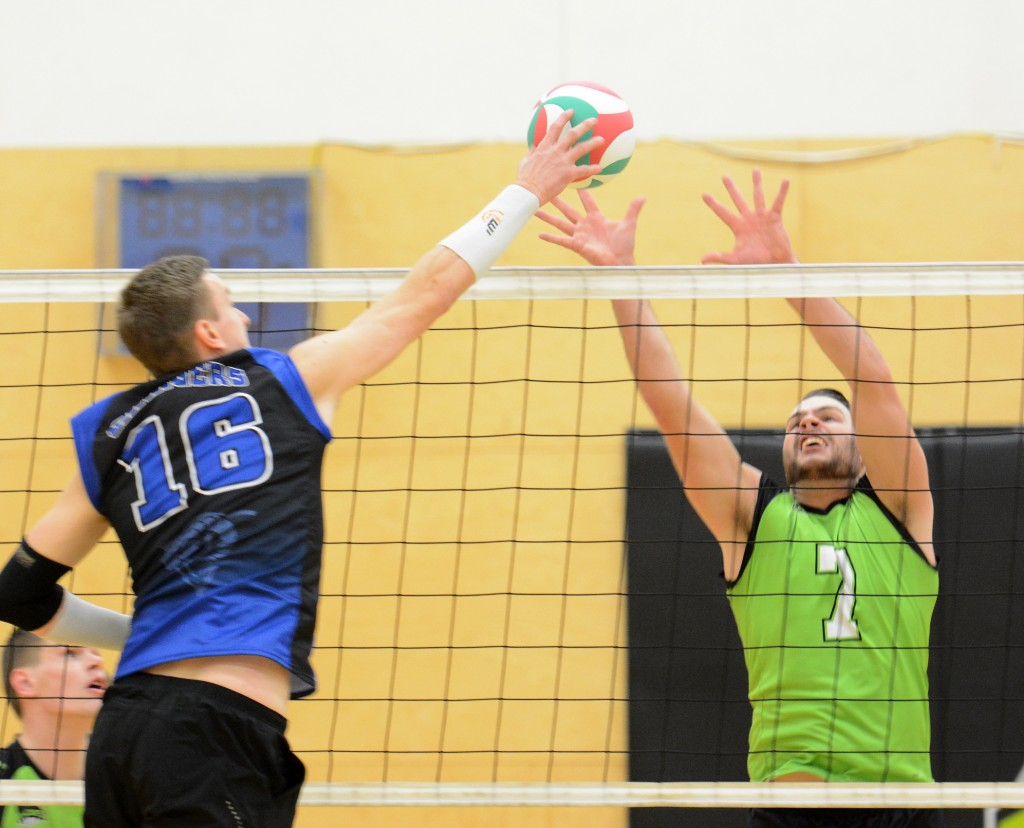 Cascades middle Dayton Pagliericci goes up for a block against the Camosun Chargers on Friday evening.