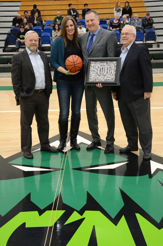UFV president Dr. Mark Evered (left) and past president Dr. Skip Bassford (right) joined Al Tuchscherer and his wife Denise in a post-game ceremony to celebrate Tuchscherer's 500th game as head coach of the Cascades.