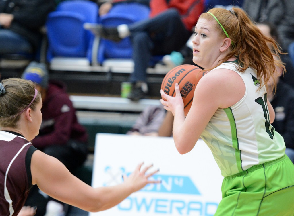 Taylor Claggett (right) is having an outstanding rookie season with the Cascades women's basketball team.