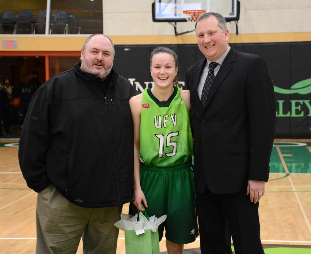 Fifth-year player Shayna Cameron posed with assistant coach Sean Bosko and head coach Al Tuchscherer after Saturday's win.