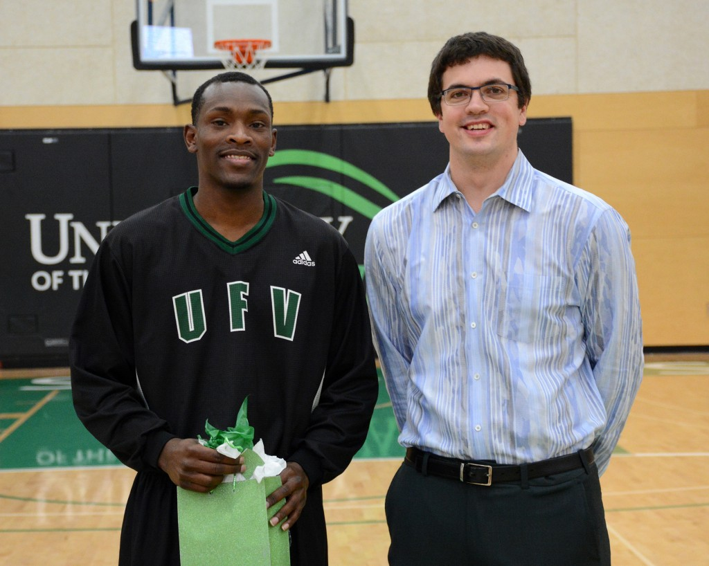 Kevon Parchment posed with head coach Adam Friesen in a Senior Night ceremony prior to the game.