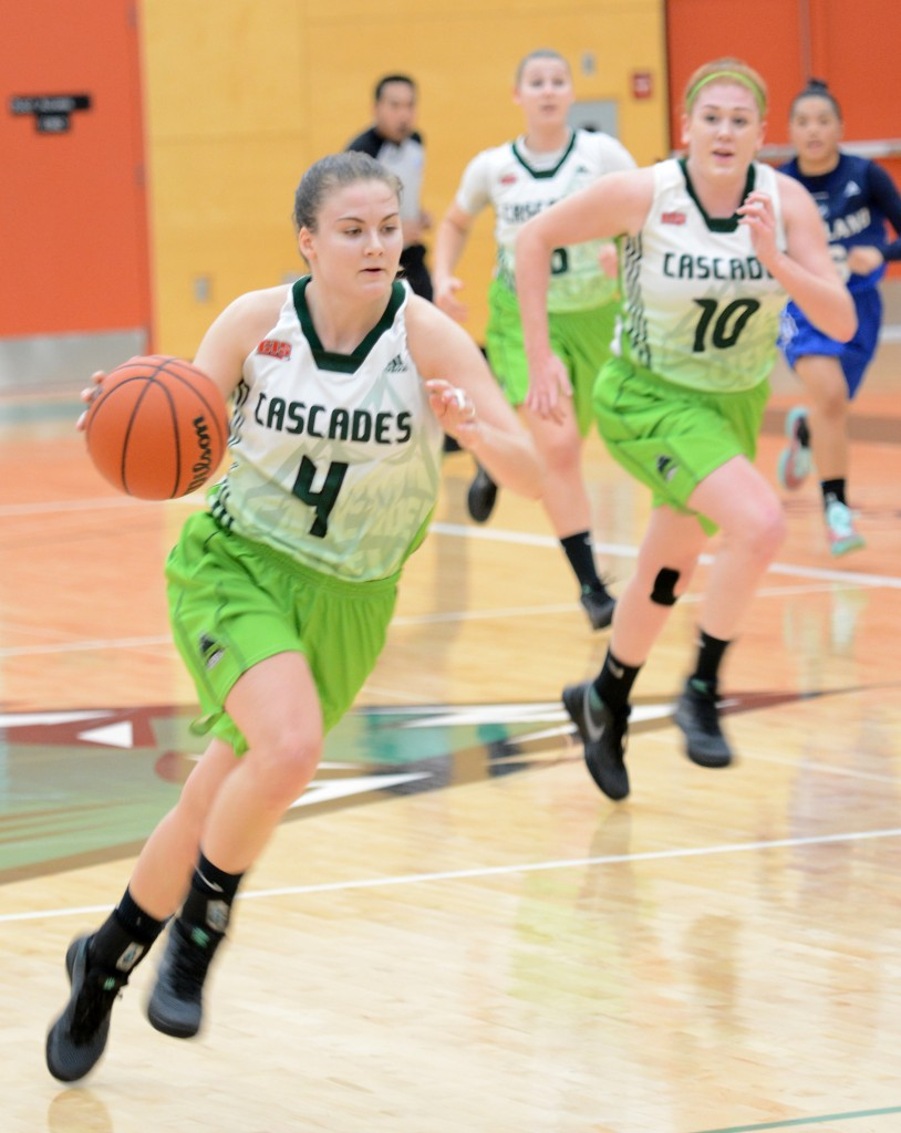 A pair of rookies, point guard Kate Head (4) and forward Taylor Claggett (10), have boosted the Cascades' fortunes this season.
