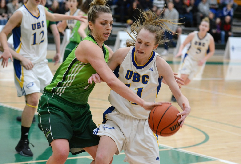 UFV's Kayli Sartori goes for the steal against UBC's Jessica Hanson.