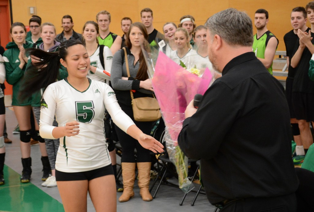Libero Ray Flores, a fourth-year player who is set to graduate, received flowers from coach Mike Gilray.