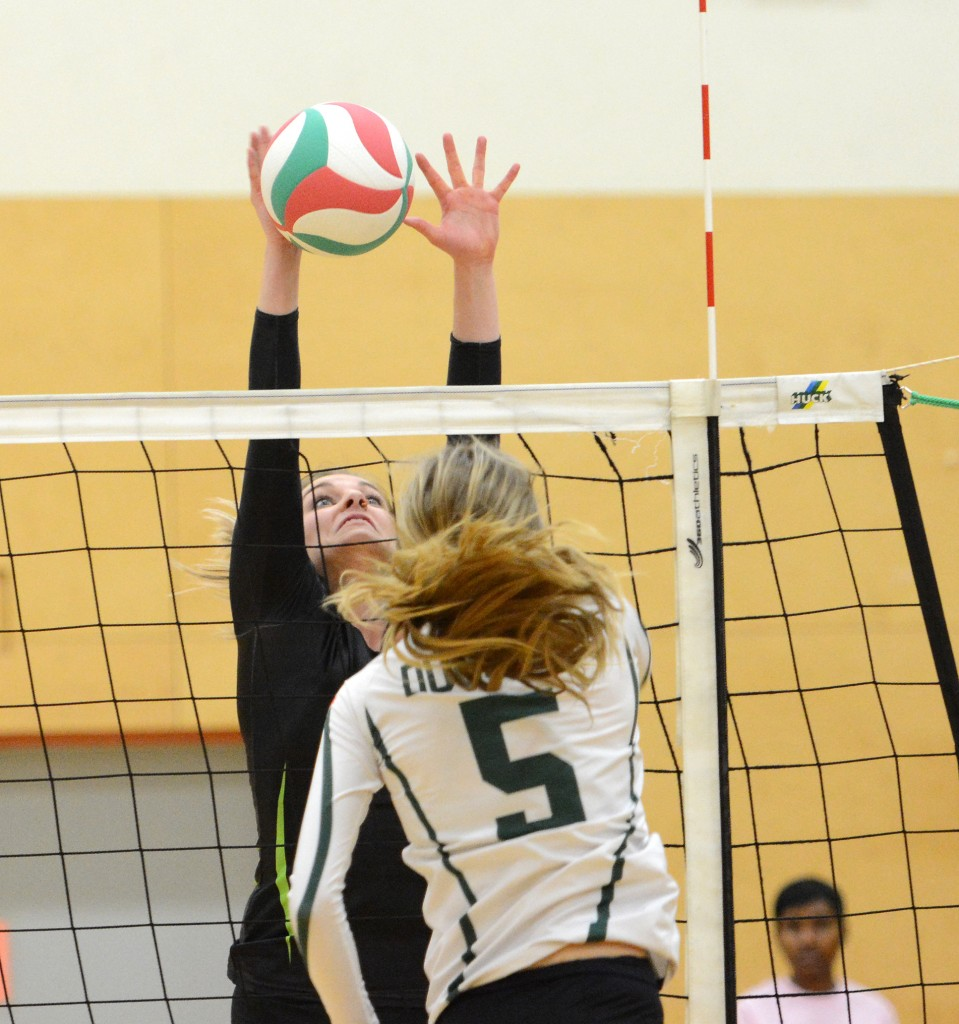 Kelly Robertson of the Cascades comes up with a big block.