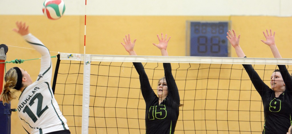 Kara Williams and Mandelyn Erikson of the Cascades go up for a block during Saturday's game vs. Douglas.