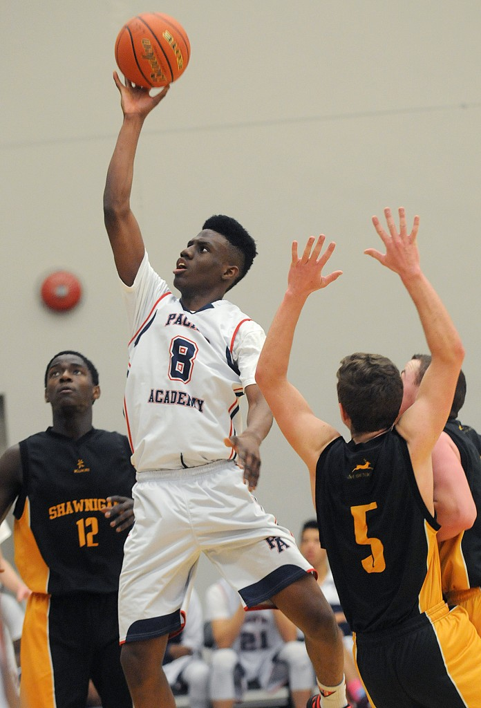 Pacific Academy's Daniel Adediran drives to the basket against Shawnigan Lake during the B.C. AA provincial basketball championships. (Evan Seal / Surrey Leader photo)