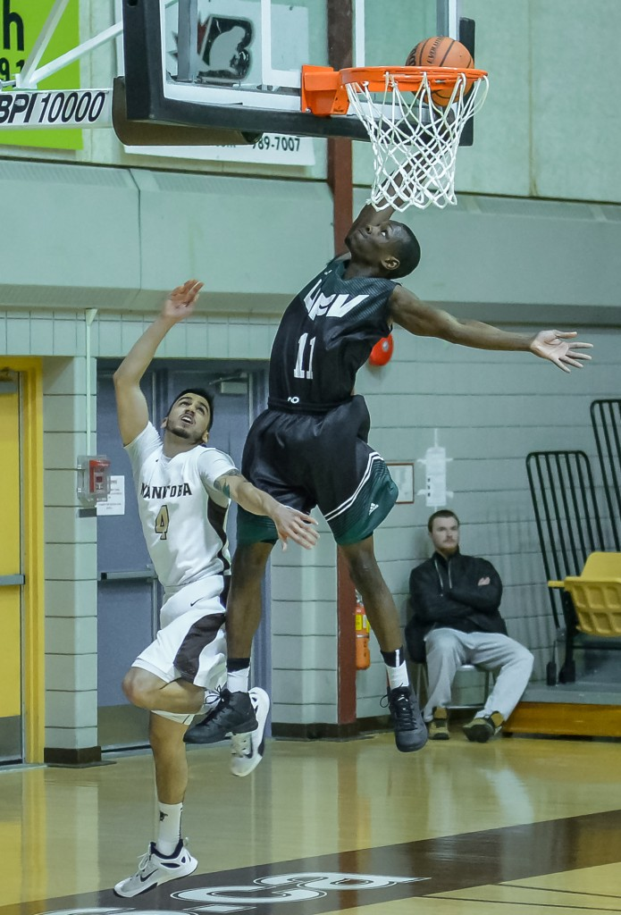 Kevon Parchment soars to the hoop against the Manitoba Bisons.
