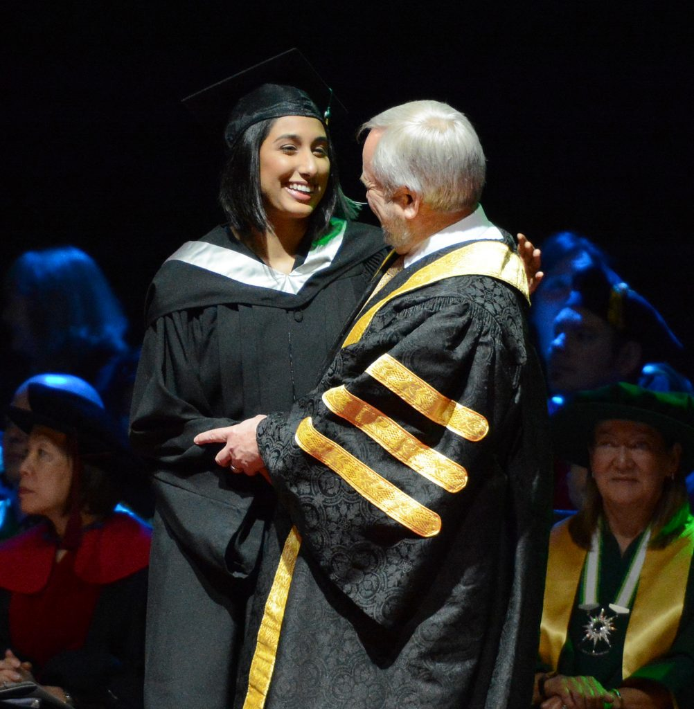 Cascades women's basketball alum Jaslyen Singh shared a moment with UFV president Dr. Mark Evered during Friday morning's convocation ceremony.