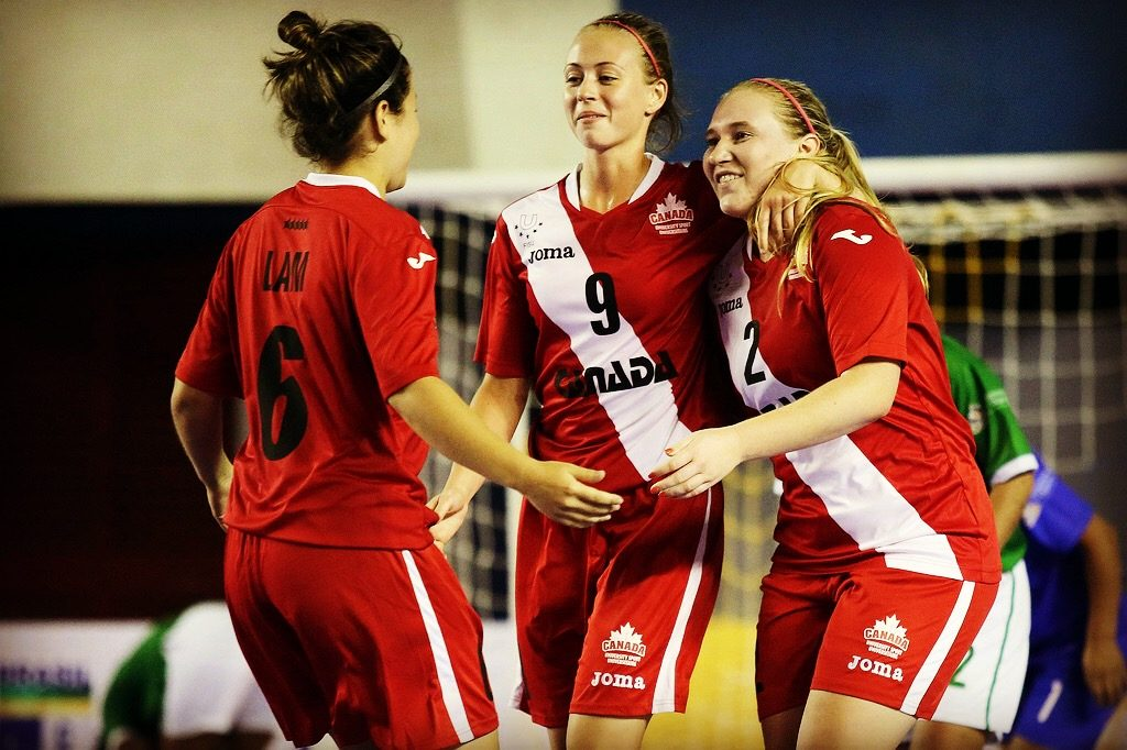 Shelby Beck (right) celebrates with teammates after scoring Canada's fourth goal in a 4-1 win over Bolivia. (FotoJump / wucfutsal2016.com)