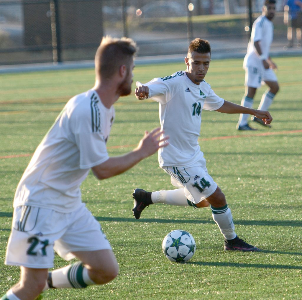 UFV's Connor MacMillan prepares to send a pass into the path of teammate James Najman.