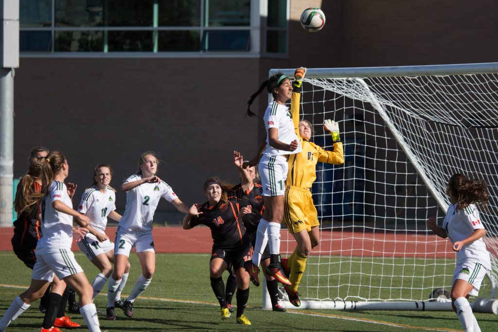 Simi Lehal of the Cascades goes up for a header against TRU keeper Alyssia Smith. (Andrew Snucins photos)