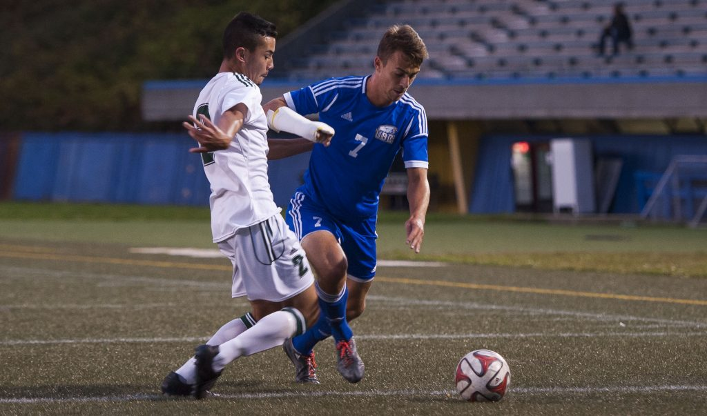 Cascades rookie defender Ryan Donald tangles with UBC's Titouan Chopin on Saturday. (Photo courtesy Rich Lam / UBC Thunderbirds)