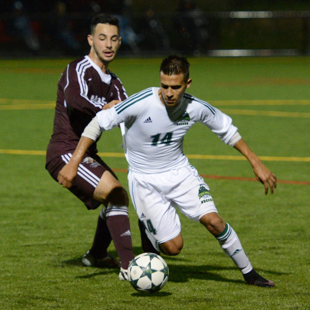 Connor MacMillan eludes a MacEwan defender.