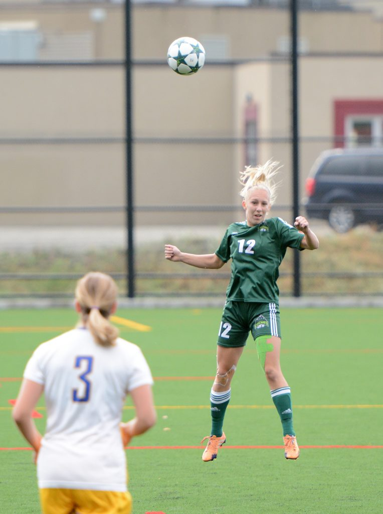 Karlee Pedersen of the Cascades rises for a header.