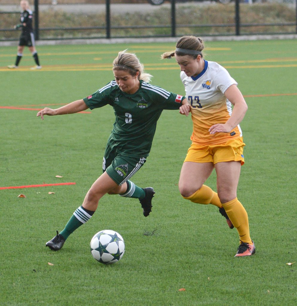 The Cascades' Danica Kump battles for the ball with UVic's Mia Gunter.