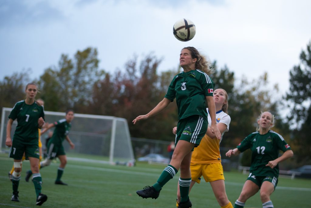 Danica Kump goes up for a header.