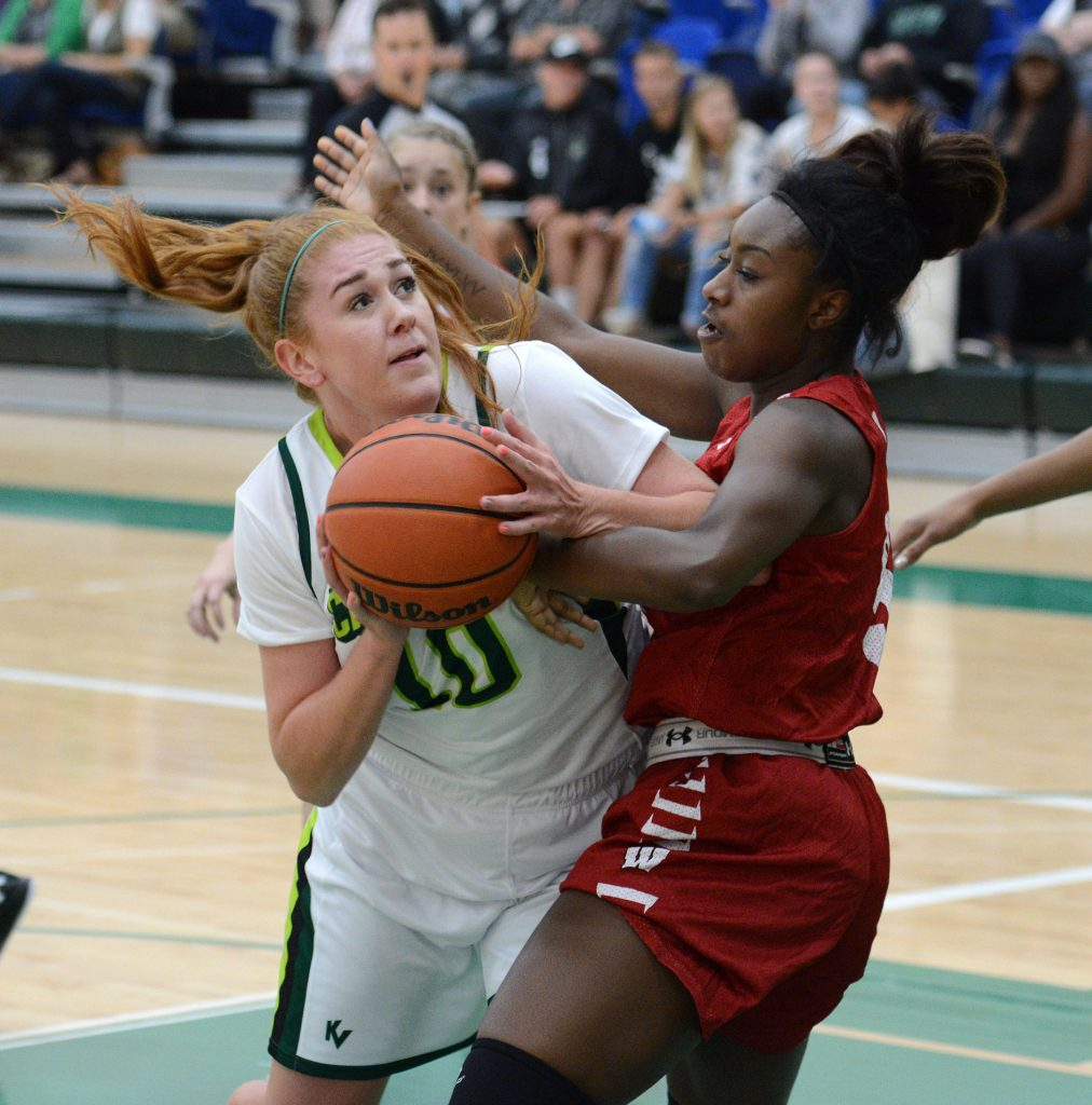 Taylor Claggett of the Cascades had eight points and 12 boards against the Carleton Ravens on Friday.