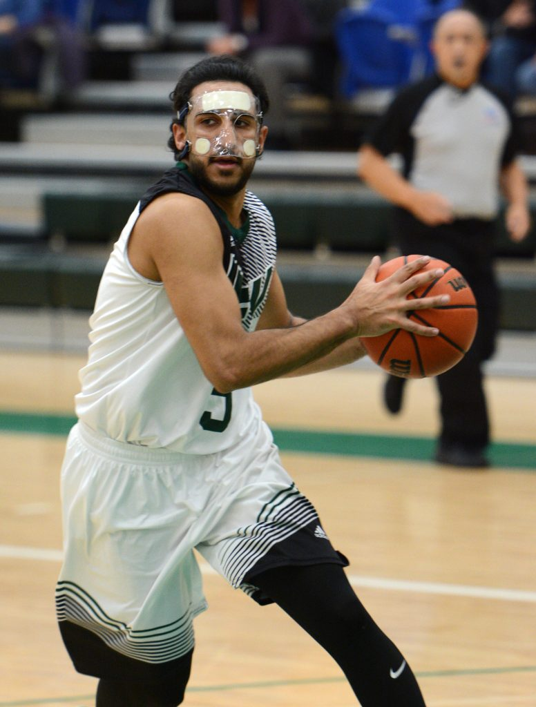 Seven of Vijay Dhillon's game-high 21 points came in the last three minutes of regulation.