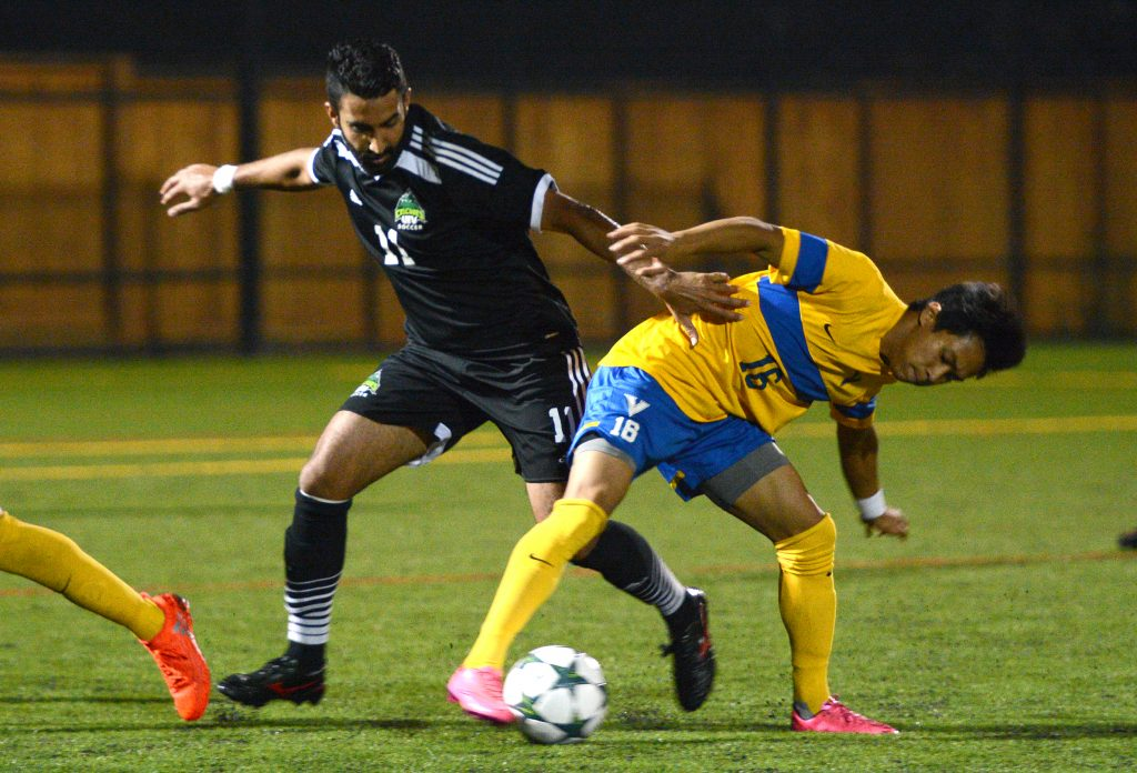 Justin Sekhon (left) scored the Cascades' third goal in Saturday's win over UVic.