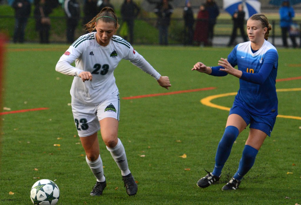 Cascades defender Desiree Caruso clears the ball away from a UVic opponent.